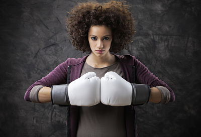 empowering women wearing boxing gloves