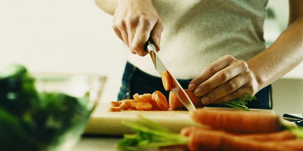 women cutting carrots
