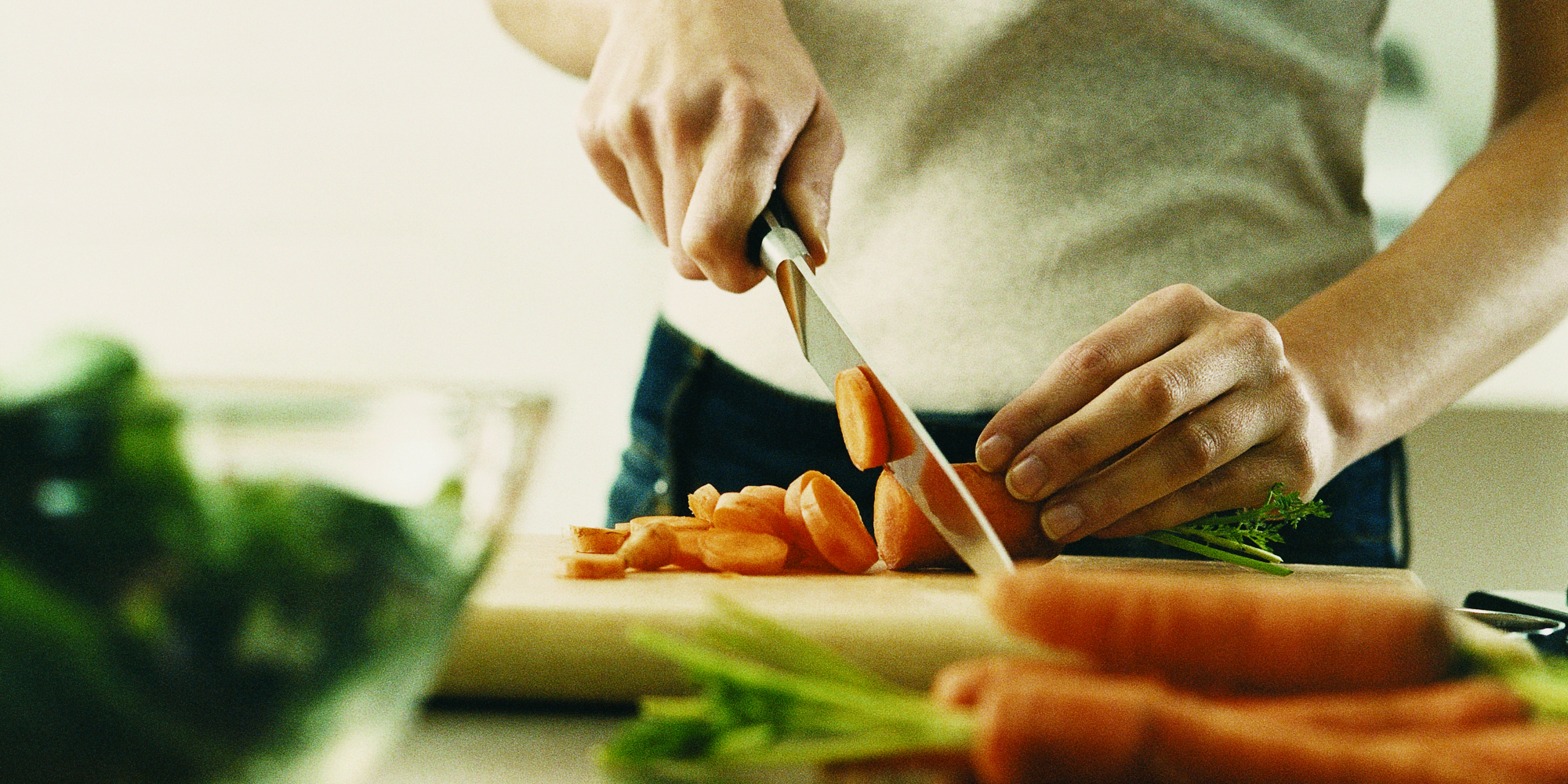 women cutting carrots